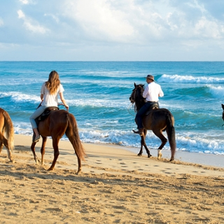 Horseback Riding On Beach